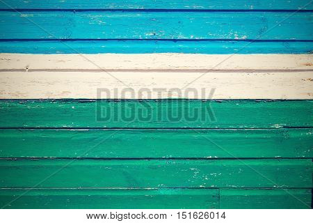 old wooden boards bright blue green color texture and background and white strip