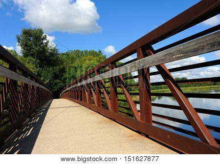 Yahara River Trail begins with a bridge over the Yahara River and Cooper's Causeway in Stoughton Wisconsin.