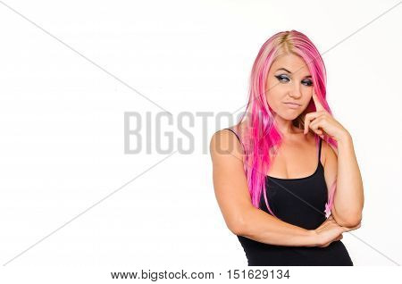 Pink hair woman looking enviously and thoughtfully