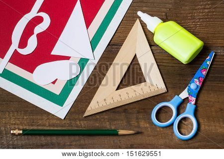 Creating a Christmas decoration for table setting. Decor for serviette in form of Santa Claus. Children project step by step photo instructions. Step 1. Preparation of materials and tools