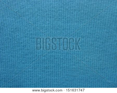 Knitted fabric texture. Knitted fabric background. Background from knitted fabric.