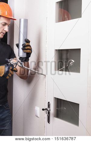 master during the installation of the door fills the gap with polyurethane foam