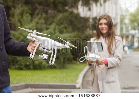 The Man Teaches Girl To Control Drone.  Aerial Video And Photogr