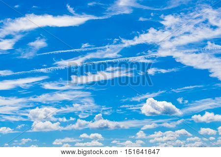 Beautiful white clouds on blue sky. Natural background.