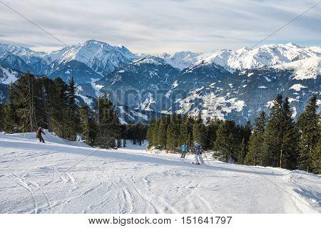 Skiers skiing down the mountain ski slopes