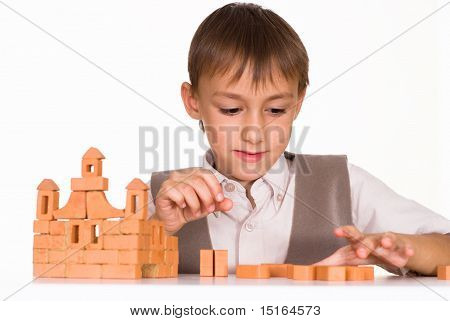 Handsome Boy Builds A Toy Castle