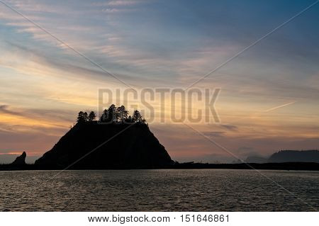 sunset over small islands in silhouette off the Washington coast on the La Push Indian Reservation USA