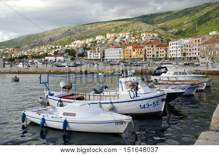 Senj Croatia - September 16 2016: a small town in northern Croatia located on the Adriatic coast. The oldest parts of buildings in the old town come from the fifteenth century. On the picture is the harbor and the boats.