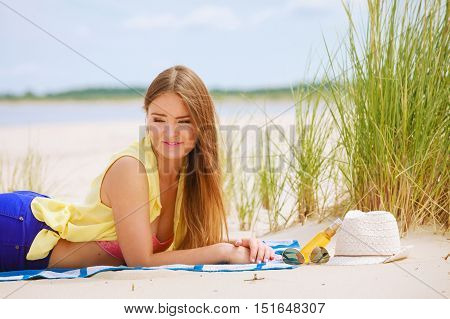 Relax and leisure. Young woman resting on summer beach. Pretty girl sunbathing on fresh air in summer.