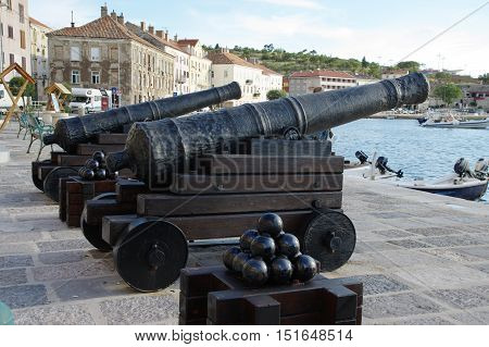 Senj Croatia - September 16 2016: a small town in northern Croatia located on the Adriatic coast. The oldest parts of buildings in the old town come from the fifteenth century. On the picture replicas of old cannon standing in the port.