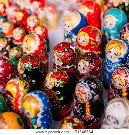 Top View Of A Bunch Of Colorful Russian Matryoshka Of Different Sizes, The Traditional Nesting Dolls, The Famous Old Wooden Souvenir At The Shop Showcase.
