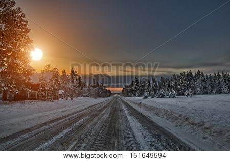 Sunset over scenic road, Lapland Finland