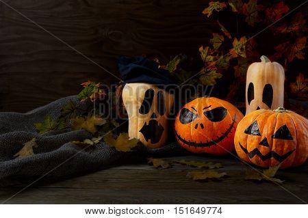 Halloween Stingy Jack pumpkins on rustic background copy space. Halloween symbol jack-o-lantern background. Halloween decoration.