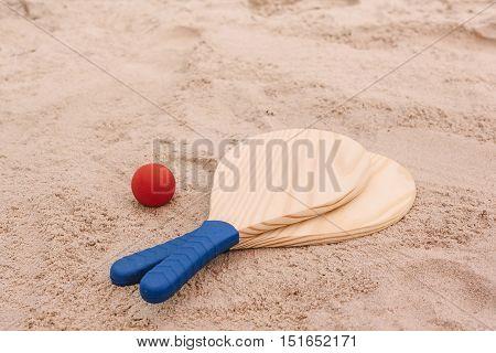 Beach Tennis, Beach Paddle Ball, Matkot. Beach Rackets And Ball On The Beach Sand