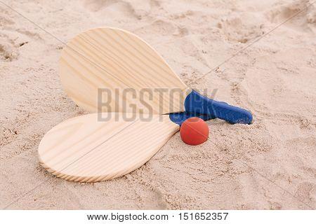 Beach tennis beach paddle ball matkot. Beach rackets and ball on the beach sand