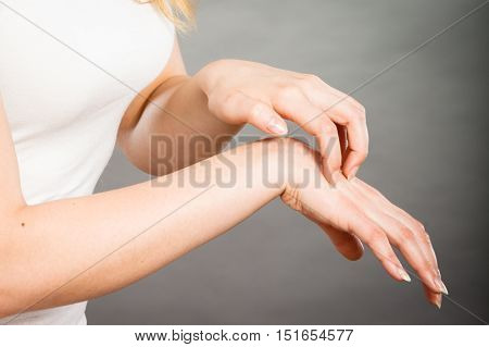Female Scratching Her Itchy Palm With Allergy Rash