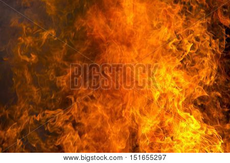 Outdoor burning fire and open flame. Black-orange background.