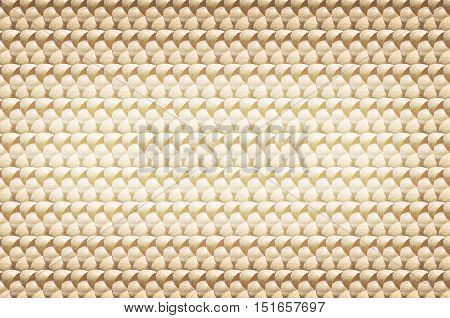 Golden abstract texture. Background made of small coconuts.