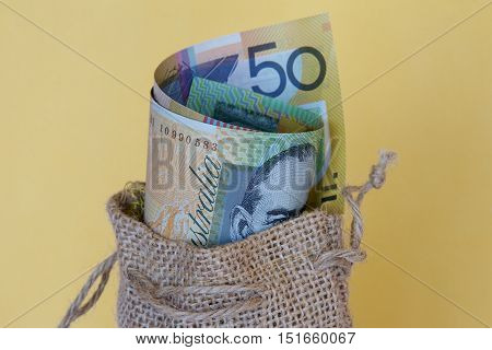 Australian dollar notes in a brown hessian bag.