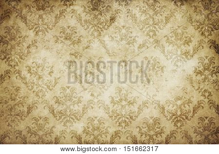 Aged dirty and yellowed paper background with shabby vintage patterns. Vintage paper texture for the design.