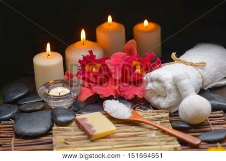 spa setting on mat with candle, cinnamon