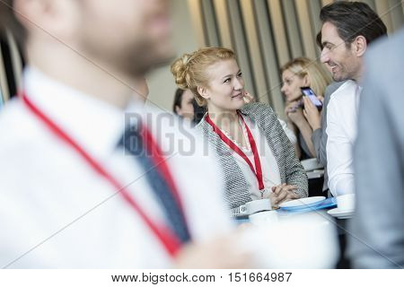 Business people talking to coffee break at lobby in convention center