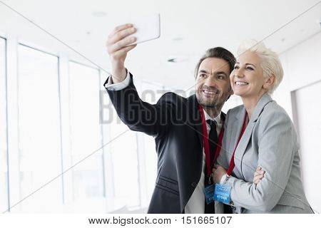 Business people taking selfie in convention center