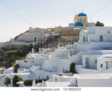 Luxury hotel with sea view. White architecture on Santorini island Greece. Beautiful summer landscape