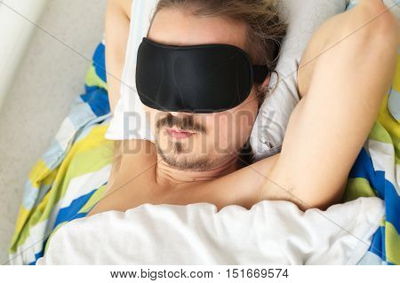 Young Mustached Husband Sleeping With Sleep Mask