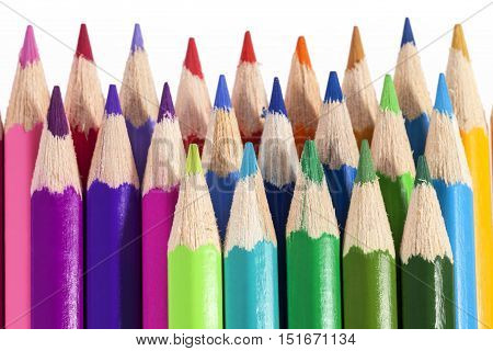Chipped colored crayons on white background close up