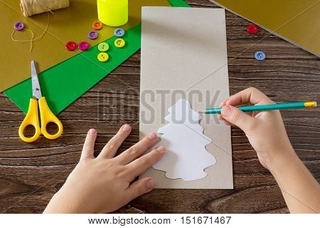 The Child Create Christmas Greeting Cards Paper Festive Fir. The Child Leads Round A Pencil Paper Fi