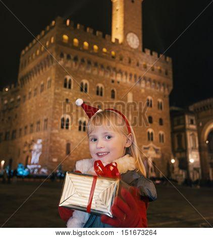 Child With Christmas Present Box Near Palazzo Vecchio, Florence
