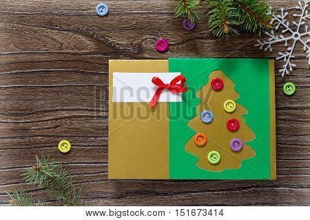 The Child Create Christmas Greeting Cards Paper Festive Fir In Christmas Tree Decorations On A Woode