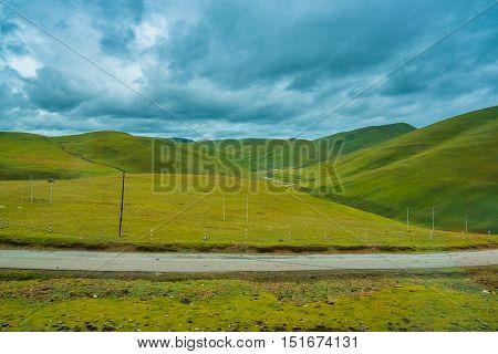 highland road to Daocheng, Daocheng, Sichuan Province, China.