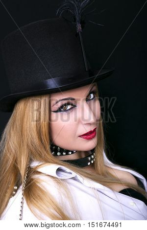 Image of sexy girl wearing black hat and posing