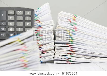 Pile Overload Document And Calculator Have Blur Paperwork As Foreground