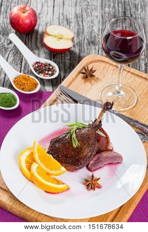 Roasted Duck Leg On Platter With Glass Of Red Wine