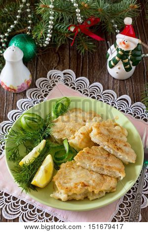 Fried Fish In Batter Potato On A Wooden Christmas Table.
