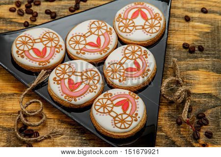 Homemade gingerbread cookies covered with icing in the form of fairy-tale carriage