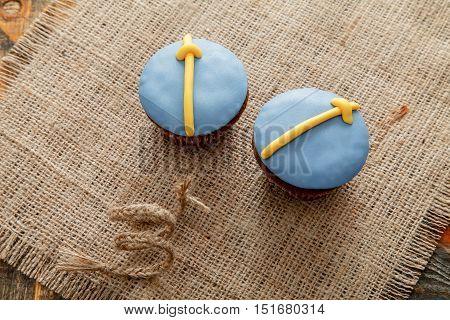 Delicious cupcakes with colored sugar mastic and decor