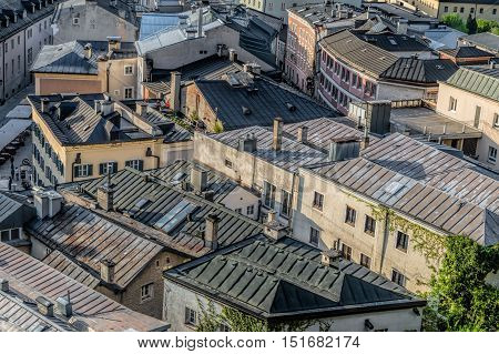Salzburg Austria - April 29 2015: Cityscape from the hill of Kapuzinerberg at dusk. Zinc roofs in residential buildings. Salzburg was the birthplace of Mozart. It is an Unesco World Heritage Site.
