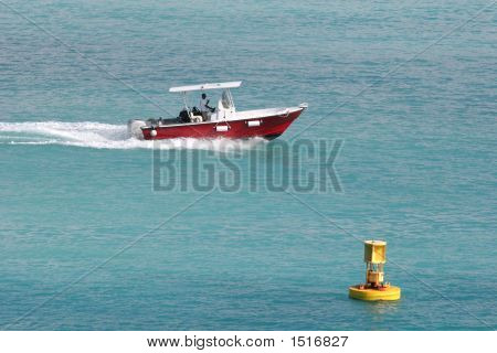 Red Boat Yellow Buoy