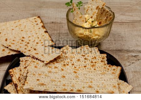 Cheese appetizer with garlic and matzo with fresh parsley leaves