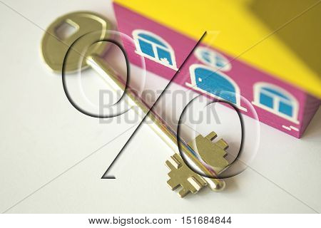 The percent sign in the background houses and apartment key . The concept of price changes on the real estate market .