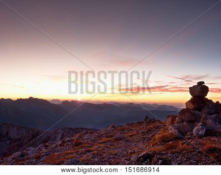 Pebbles Pyramid. Stones On Apine Gravel Mountain Summit. Daybreak Horizon