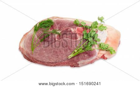 Big piece of fresh uncooked pork obtained from the cross cut of hind leg and twigs of fresh cilantro and dill on a light background