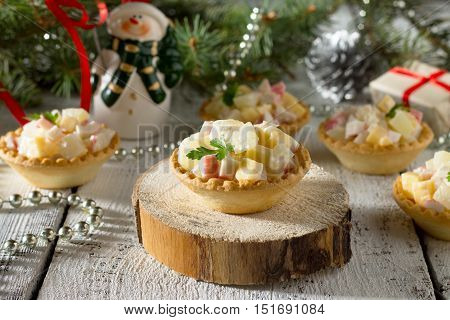 Holiday Hors D'oeuvre: Tartlets With Crab Sticks, Cheese And Pineapple On A Celebratory Christmas Ba