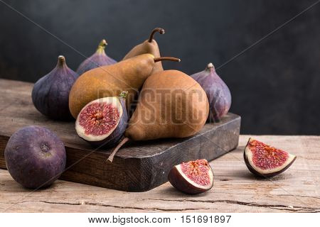 Different fruits on a wooden board