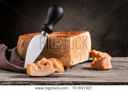 Still life of cheese on a wooden board