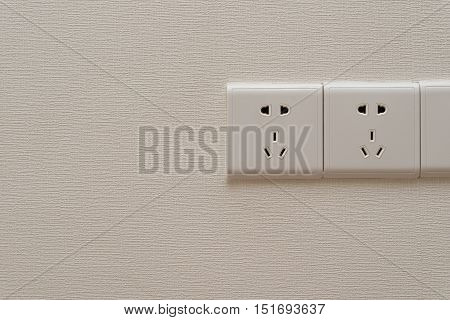 three electrical outlets on a wall horizontal